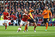 Nottingham Forest midfielder Henri Lansbury (10) is fouled on the edge of the penalty area during the Sky Bet Championship match between Nottingham Forest and Wolverhampton Wanderers at the City Ground, Nottingham, England on 30 April 2016. Photo by Jon Hobley.
