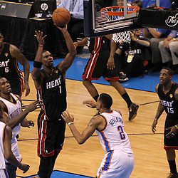 Jun 14, 2012; Oklahoma City, OK, USA;  Miami Heat power forward Chris Bosh (1) shoots against the Oklahoma City Thunder during the second quarter of game two in the 2012 NBA Finals at Chesapeake Energy Arena. Mandatory Credit: Derick E. Hingle-US PRESSWIRE