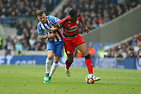 Football - 2017 / 2018 Premier League - Brighton and Hove Albion vs. Huddersfield Town<br /> <br /> Terence Kongolo of Huddersfield Town gets pulled back by  Pascal Gross of Brighton at The Amex Stadium Brighton <br /> <br /> COLORSPORT/SHAUN BOGGUST