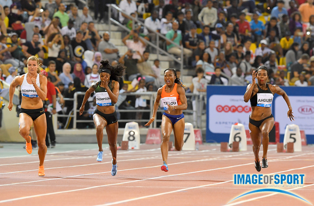 Marie-Josée Ta Lou aka Marie-Josee Ta Lou (CIV), second from right, wins the women's 100m in 10.85 in the 2018 IAAF Doha Diamond League meeting at Suhaim Bin Hamad Stadium in Doha, Qatar, Friday, May 4, 2018. From left: Dafne SChippers (NED), Elaine Thompson (JAM), Ta Lou and Murielle Ahoure (CIV).  (Jiro Mochizuki/Image of Sport)