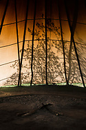 Peyote ceremony, Native American Church, sunrise illuminates peyote tipi and half moon peyote alter after ceremony, Crow Indian Reservation, Montana