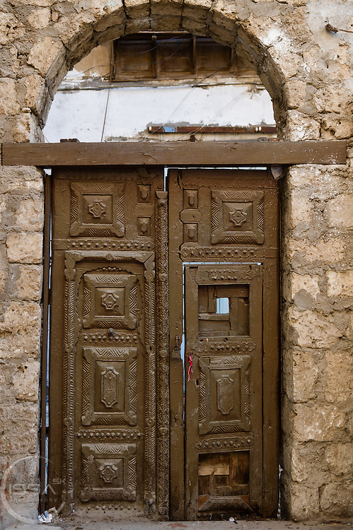 Door under a stone arch in Old town Jeddah