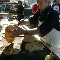 A man cooks traditional talo (corn tortilla) at the Saint Thomas Christmas fair, 21 December 2005 a traditional christmas market in the northern Spanish Basque city of Bilbao where peasants sell their products. Photo Rafa Rivas