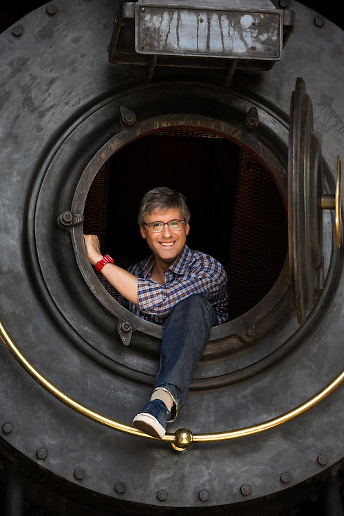 Mo Rocca inside of the front of a train while filming The Henry Ford's Innovation Nation, CBS Saturday morning TV program.<br />