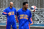 "The Harlem Globetrotters' Deandre ""Dragon"" Taylor, right, and Jonathan ""Hawk"" Thomas show off some basketball handling skills in advance of a pair of upcoming dates for shows at the Arena at Gwinnett during a rare day off, Monday, March 9, 2015, in Atlanta. David Tulis / AJC Special"
