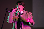 Mark Casey of Rochester performs karaoke at Bowioke at Visual Studies Workshop in Rochester on Saturday, October 31, 2015. The night included David Bowie karaoke and a reenactment of Bowie's 1976 arrest in Rochester.