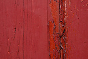 Peeling red paint.