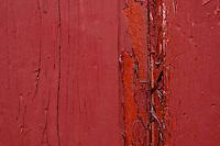Peeling red paint.