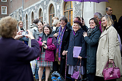 © London News Pictures. 20/11/2012. London, UK . Female members of the Church of England clergy dressed in purple (campaign colour) pose for a photograph as they  arrive at Church House in Westminster, London for day two of the three-day Church of England General Synod. Members will vote on whether to allow women to become bishops, 20 years after the Church decided to ordain women as priests. Photo credit: Ben Cawthra/LNP