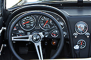 During summer from June to Septemper, every first Friday of the month is Vintage Car Cruising Night. Hundreds of classic American cars cruise around downtown Helsinki and meet at special places to have a good time, here at Kaivopuisto (Brunnsparken). Here the cockpit of a Chevrolet Corvette Sting Ray Fastback Coupe?.