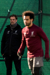 LIVERPOOL, ENGLAND - Monday, February 18, 2019: Liverpool's manager Jürgen Klopp looks towards Mohamed Salah during a training session at Melwood ahead of the UEFA Champions League Round of 16 1st Leg match between Liverpool FC and FC Bayern München. (Pic by Paul Greenwood/Propaganda)
