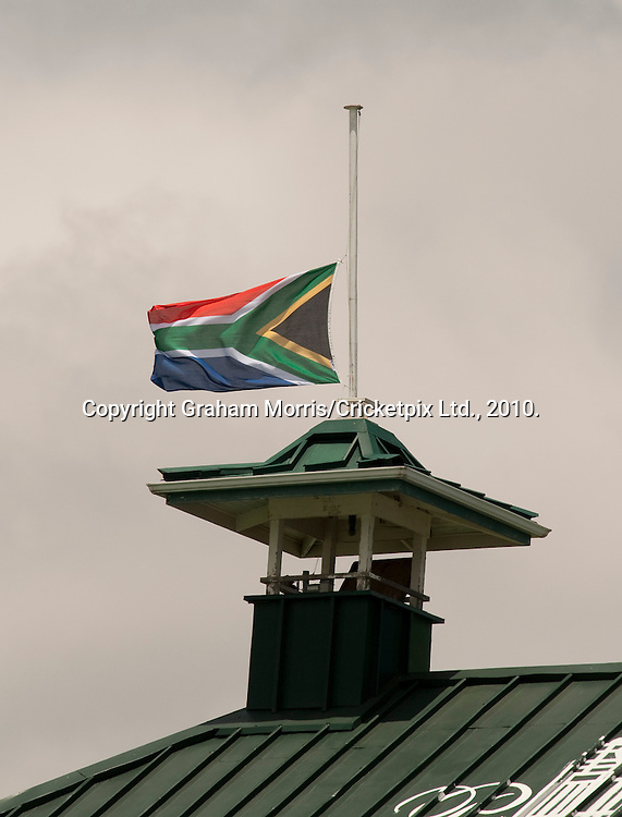 The South African flag flying at half-mast during the third Test Match against England at Newlands, Cape Town. Photograph © Graham Morris/cricketpix.com (Tel: +44 (0)20 8969 4192; Email: sales@cricketpix.com)