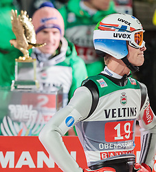 29.12.2015, Schattenbergschanze, Oberstdorf, GER, FIS Weltcup Ski Sprung, Vierschanzentournee, Bewerb, im Bild Severin Freund (GER) vor den Pokal des Gesamtsiegers, Daniel Andre Tande (NOR) // Severin Freund of Germany behind the Overall Trophy and Daniel Andre Tande of Norway reacts after his 2nd Competition Jump of Four Hills Tournament of FIS Ski Jumping World Cup at the Schattenbergschanze, Oberstdorf, Germany on 2015/12/29. EXPA Pictures © 2016, PhotoCredit: EXPA/ JFK