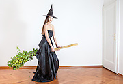 beautiful witch tries out her new eco broom
