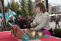 A musician plays Edelweiss and other songs on cowbells during the 2010 Olympic Winter Games in Whistler, BC Canada.