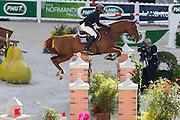 Mohammed al Kumaiti - Pacha du Fort<br /> Alltech FEI World Equestrian Games™ 2014 - Normandy, France.<br /> © DigiShots