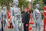 The Grafitti artist who painted the slogans. ActionAid's International Safe Cities for Women Day at Marble Arch, with an interactive exhibition featuring a group of 30 mannequins, London.<br /> Picture date: Thursday May 19, 2016. A third of the mannequins featured in the installation will be marked in red, to represent the one in three women who experience violence in their lifetimes. But behind every statistic is a real woman, and on each mannequin are quotes from women around the world telling their experience of urban violence and the stories behind the statistics. ActionAid is campaigning for the UK government to commit to increasing the proportion of aid going directly to women's groups working on the frontline in poor communities. (photo by Andrew Aitchison ActionAid)