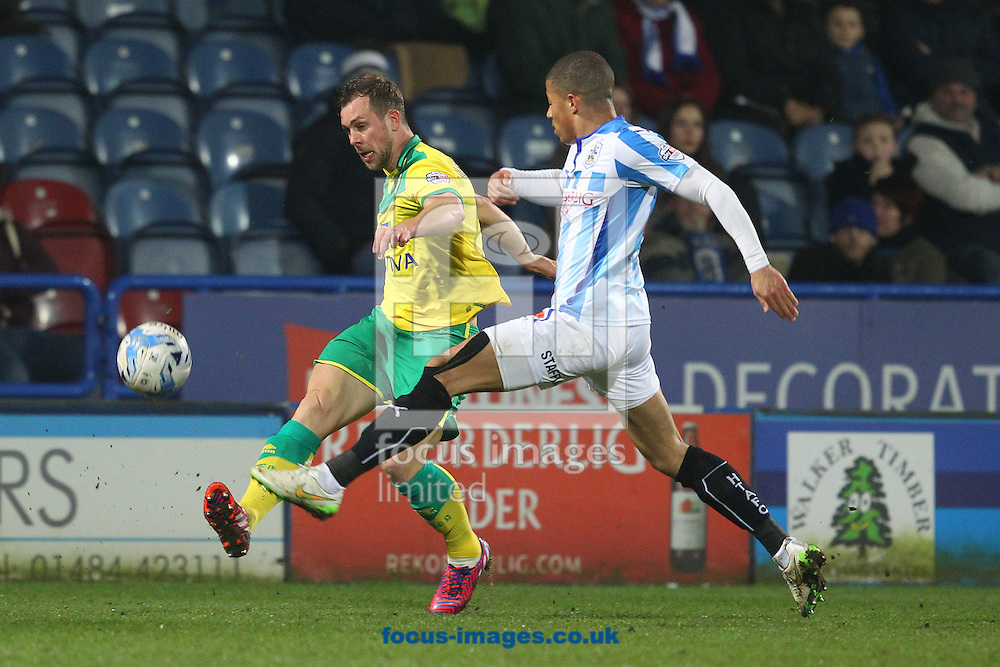 Steven Whittaker of Norwich and James Vaughan of Huddersfield Town in action during the Sky Bet Championship match at the John Smiths Stadium, Huddersfield<br /> Picture by Paul Chesterton/Focus Images Ltd +44 7904 640267<br /> 17/03/2015