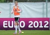 FUSSBALL INTERNATIONAL  EURO 2012   07.06.2012  Training der Deutschen Nationalmannschaft in Danzig Andre Schuerrle (Deutschland)   vor einer Werbebande UEFA EURO 2012