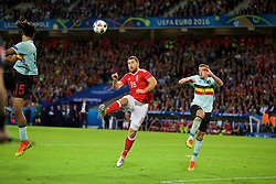 LILLE, FRANCE - Friday, July 1, 2016: Wales' Sam Vokes scores the third goal against Belgium during the UEFA Euro 2016 Championship Quarter-Final match at the Stade Pierre Mauroy. (Pic by David Rawcliffe/Propaganda)