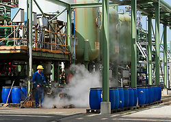 An employee performs routine maintenance on equipment at the Solvay SA chemical plant in Antwerp, Belgium, on Thursday, April 22, 2010.  Solvay SA is the world's largest supplier of Soda Ash or Sodium Carbonate and is also a major producer of caustic soda, hydrogen peroxide, chlorine and fluorinated products. (Photo © Jock Fistick)