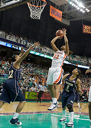 Virginia guard Monica Wright (22) shoots over Georgia Tech forward Alex Montgomery (22).  The #4 seed/#25 ranked Virginia Cavaliers women's basketball team defated the #5 seed Georgia Tech Yellow Jackets 52-43 in the quarterfinals of the 2008 ACC Women's Basketball Tournament at the Greensboro Coliseum in Greensboro, NC on March 7, 2008.