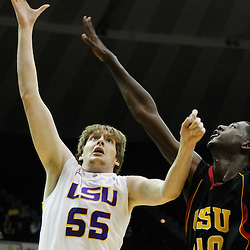 December 29, 2011; Baton Rouge, LA; LSU Tigers center Andrew Del Piero (55) shoots over Grambling State Tigers center Peter Roberson (40) during the second half of a game at the Pete Maravich Assembly Center.  LSU defeated Grambling State 69-37. Mandatory Credit: Derick E. Hingle-US PRESSWIRE