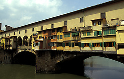 Florence, Italy:  The Ponte Vecchio (1345), the oldest bridge in the city, is home to numerous goldsmiths and jewelers.