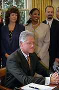 US President Bill Clinton following his weekly radio address in the Oval Office of the White House September 12, 1998 in Washington, DC. The president delivered his radio address on Helping Communities to Keep Kids Drug-Free as US drug czar Barry McCaffrey stands behind along with other leaders.