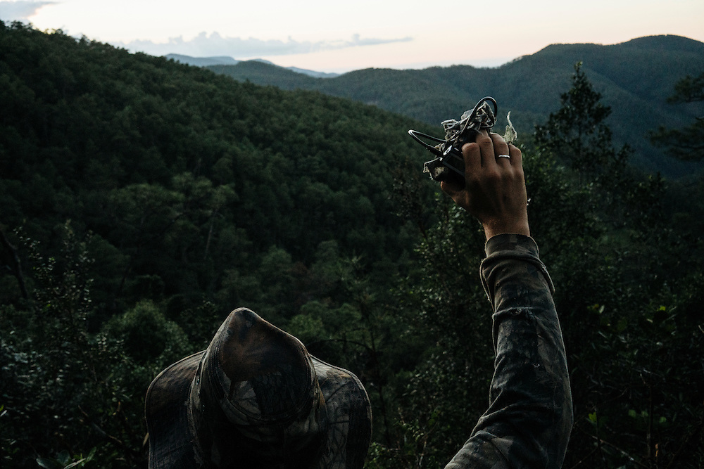 Using the feedback call of the ivory-billed woodpecker, Martjan Lammertink waits to hear any response in Humbolt National Park in Eastern Cuba on Feb. 1, 2016.