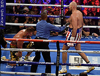LAS VEGAS, NEVADA - JUNE 15:  Boxer Tyson Fury(R) hits Tom Schwarz as he goes down during the second round at the MGM Grand Garden Arena on June 15, 2019 in Las Vegas, Nevada. Tyson Fury took the win by TKO after the fight was stop in the second round. MB Media