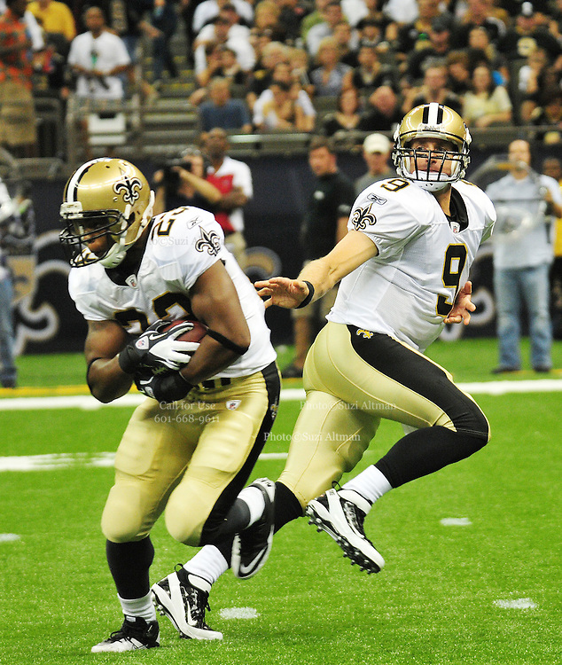 The New Orleans Saints QB Drew Brees 9 in his first huddle and hand off pass to rookie Mark Ingram 28,RB, since the lockout during the first preseason NFL game against the San Francisco 49ers Friday August 12,2011 its the first preseason NFL game and the first NFL game since the lockout. Saints rookie and Heisman trophy winner RB Mark Ingram 28, runs for his first NFL touchdown.The Saints won 24-3. Photo© Suzi Altman.com