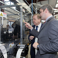 CEO Terry Fox shows Minister of State for Trade, Employment, Business, EU Digital Single Market and Data Protection Pat Breen the Production line of CupPrint, Ennis