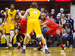Feb 18, 2017; Morgantown, WV, USA; Texas Tech Red Raiders forward Anthony Livingston (21) guards West Virginia Mountaineers forward Nathan Adrian (11) during the first half at WVU Coliseum. Mandatory Credit: Ben Queen-USA TODAY Sports