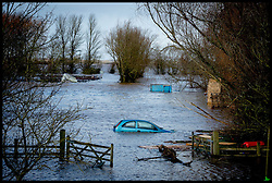Burrowbridge, Somerset, United Kingdom.Sunday, 9th February 2014. A car is submerged in flood water in  Burrow Bridge as the Somerset levels continue to flood.  The levels have been flooded since the start of 2014, with people being forced to leave their homes. Picture by Andrew Parsons / i-Images