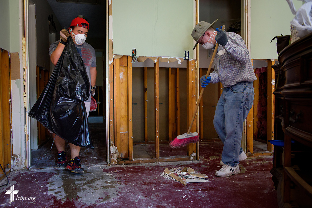 Erik Brown (left) and Eric Hollar, volunteers from Memorial Lutheran Church, Katy, Texas, clear debris at a home damaged by Hurricane Harvey on Friday, Sept. 1, 2017, in Katy.  LCMS Communications/Erik M. Lunsford