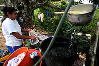 A woman washes clothes in El Ofrio, a small remote village in the southern Colombian state of Nariño, on Monday, June 25, 2007. There are coca fields located in the vicinity of El Ofrio, but the residents know that soon fumigation and manual eradication of their coca crops by the Colombian government will force them to find a new means to earn cash. (Photo/Scott Dalton)