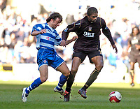 Photo: Leigh Quinnell.<br /> Reading v Portsmouth. The Barclays Premiership. 17/03/2007. Portsmouths Nwankwo Kanu fights off Readings Stephen Hunt.