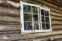 Window detail of a log cabin on Isle au Haut, Maine, USA