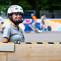 London, UK - 24 August 2012: a girl wears her helmet at the Hell's Belles Vol 2, Ladies Bike Polo Tournament in Bethnal Green Gardens.