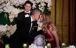 United States President Barack Obama, center, kisses Mrs. Sophie Grégoire Trudeau of Canada after offering a toast during a state dinner honoring her and Prime Minister Justin Trudeau of Canada, left, at the White House March 10, 2016 in Washington, DC. EXPA Pictures © 2016, PhotoCredit: EXPA/ Photoshot/ Olivier Douliery<br /> <br /> *****ATTENTION - for AUT, SLO, CRO, SRB, BIH, MAZ, SUI only*****