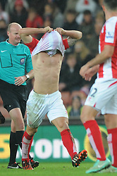Stoke's Phillip Bardsley pulls his shirt over his head in frustration - Photo mandatory by-line: Dougie Allward/JMP - Mobile: 07966 386802 - 29/10/2014 - SPORT - Football - Stoke - Britannia Stadium - Stoke City v Southampton - Capital One Cup - Fourth Round
