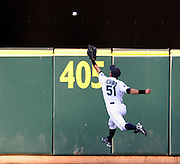 Seattle Mariners Ichiro Suzuki can't make the catch in center field on Detroit Curtis Granderson double during the third inning of today's MLB baseball game against the Detroit Tigers in Seattle, on Thursday, July 12, 2007. (AP Photo/Kevin P. Casey)