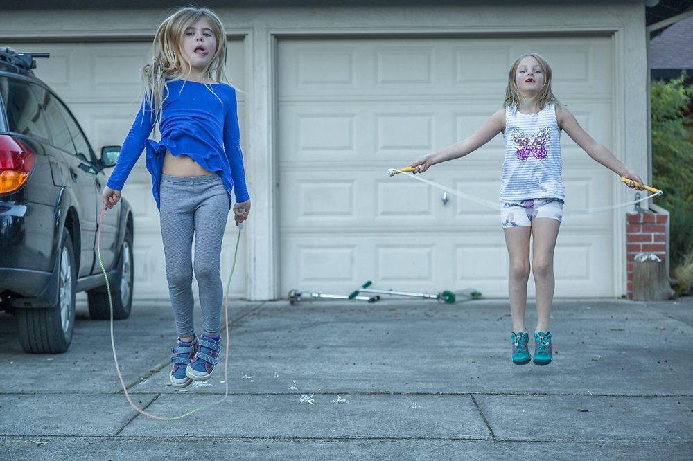 Ella Fitzpatrick (right) Jumpropes in front of her house with her Friend Lucia.