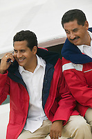 Men on Boat with Cell Phone
