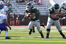 17 September 2011: Cameron Blossom stares down Kevin Glock while getting blocking help from Zach Anderson during an NCAA Division 3 football game between the Aurora Spartans and the Illinois Wesleyan Titans on Wilder Field inside Tucci Stadium in.Bloomington Illinois.
