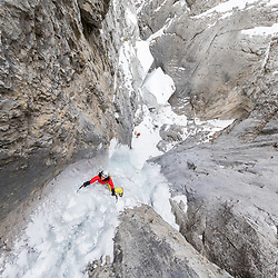 Samira Szymiec ice climbing the last pitch of Urs Hole in Banff National Park, Alberta, Canada