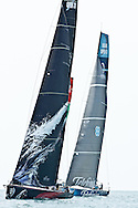 Puma and Telefonica with Groupama peeking out to windward during ProAm races at the 2011-2012 Volvo Ocean Race Miami.