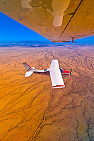 Two Desert Air Cessna 210's fly above the Namib Desert, Namibia