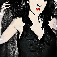 A young woman wearing a black dress and red lipstick looking startled